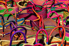 A bazaar of colored baskets. All the colors of the rainbow make up this collection of multicolored weaved baskets Royalty Free Stock Photography