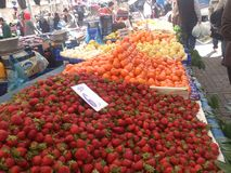 Bazaar. Foods and fruits. market place at istanbul. strawberry and mandarin. colorful Stock Photography