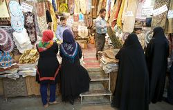 Bazaar. Iranian women are buying goods at the Vakil Bazaar, Shiraz, Iran. The bazaar is located in the historical centre of the town royalty free stock photography