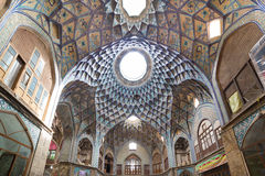 Bazaar of Kashan, in Iran. Timcheh-e Amin o Dowleh, Kashan Bazaar (19th century), in Iran. Persian architects used these structures to naturally decrease stock photography