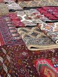 bazar Bukhara protestuje orientalnych dywaniki Zdjęcia Stock