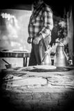 Bazlama and hot tea. Bazlama baking on a wood stove and smoking tea pot, at a market near Antalya (Turkey Royalty Free Stock Image