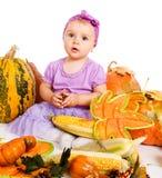 Bébé avec la récolte d'automne Photos stock