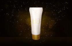 BB cream bottle mock up in golden glitter on black background Foundation tube in gold sparkles shimmer 3D illustration Royalty Free Stock Images