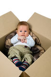 Bébé garçon dans la boîte Photos libres de droits