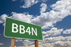 BB4N Green Road Sign Over Sky Stock Images