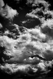 Bbackground of black and white dramatic monochrome cumulus clouds. Cloudscape background of black and white dramatic monochrome cumulus clouds Stock Photos