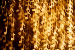 Bbackground of music notes. Blurring lights bokeh background of music notes Royalty Free Stock Photography