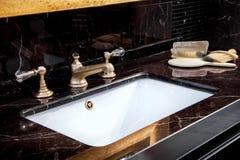 Bbath sink in a bathroom Royalty Free Stock Photos