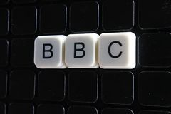 BBC control text word title caption label cover backdrop background. Alphabet letter toy blocks on black reflective background. BBC Stock Photos