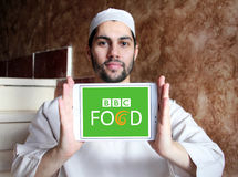 Bbc food logo. Logo of bbc food channel on samsung tablet holded by arab muslim man Royalty Free Stock Photo