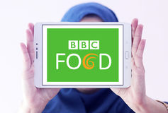 Bbc food logo. Logo of bbc food channel on samsung tablet holded by arab muslim woman Stock Image