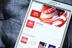 Bbc news channel app logo. Downloading bbc news channel application from google play store on samsung tab s2 royalty free stock images