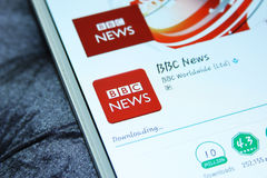 BBC news mobile app. Downloading BBC news mobile application from google play store on samsung tablet stock photo
