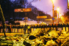BBC reporters in front of the riot police in Kiev Stock Photos