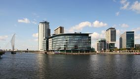 BBC Studio in Manchester. Time lapse view looking across river Irwell to the BBC Studios at MediaCityUK in Salford Quays, Manchester, England stock footage