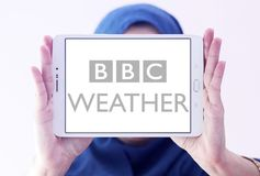 BBC Weather logo. Logo of BBC Weather on samsung tablet holded by arab muslim woman. BBC Weather is the BBC`s department in charge of preparing and broadcasting Royalty Free Stock Photography