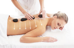 A bbeautiful and healthy woman getting alternative massage Royalty Free Stock Photography