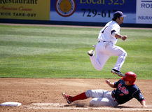 BBinghamton Mets' shortstop Rylan Sandoval. Binghamton Mets' shortstop Rylan Sandoval completes the double play Stock Photos