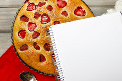 Bblank sheet of paper and round strawberry pie Royalty Free Stock Image