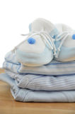 BBlue Baby Shoes on Baby Clothes Stock Photos