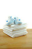 BBlue Baby Shoes on Cotton Diapers Stock Image