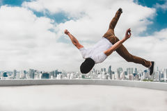 Bboy doing some stunts on the roof Stock Photo