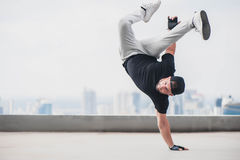 Bboy doing some stunts on the roof Royalty Free Stock Photos