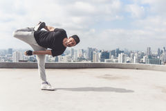 Bboy doing some stunts. Street artist breakdancing outdoors. Bboy doing some stunts - Street artist breakdancing outdoors Stock Photos