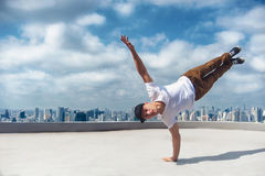 Bboy doing stunt at the roof stock image