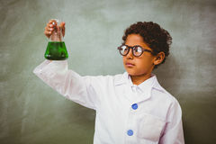 Bboy holding conical flask in classroom Royalty Free Stock Photo