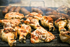 BBQ. Chicken legs being cooked on a grill Stock Images