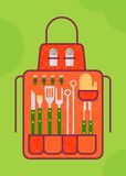 Bbq apron with bbq tools Stock Photography