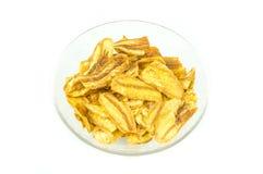BBQ assaisonné par puce légèrement découpé en tranches frit de banane Image stock