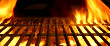BBQ or Barbecue or Barbeque or Bar-B-Q Charcoal Fire Grill. BBQ or Barbecue or Barbeque or Bar-B-Q Charcoal Fire Iron Empty Grill with Flames  on Black Stock Photography