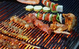 BBQ barbecue on chicken wings, pork, grilled skewers 02. BBQ barbecue on chicken wings, pork, grilled skewers royalty free stock image