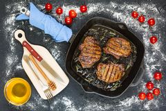 Bbq, barbecue, steaks, grill, picnic, grilled meat, outdoor meal. Grilled pieces of delicious rump steak garnished with herbs and sauce a in a frying pan grilled Royalty Free Stock Images