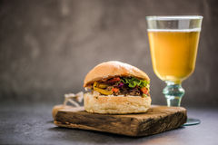 BBQ beef bun and glass of Ale Stock Image