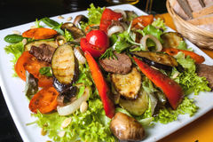 Bbq : beef (pork) steak garnished with apples Royalty Free Stock Images
