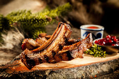 BBQ Boar Spare Ribs Served on Rustic Wood Plank Stock Photo