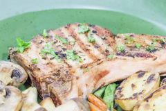 Bbq bone in pork chop. With vegetable Royalty Free Stock Photography