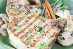 Bbq bone in pork chop. With vegetable Stock Photo