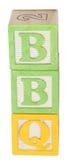 BBQ buchstabiert in den Alphabet-Blöcken Lizenzfreies Stockbild