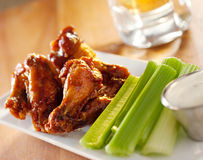 Bbq buffalo wings with celery and ranch. Royalty Free Stock Photo