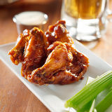 Bbq buffalo wings with celery and ranch. Stock Photos