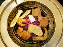 BBQ buffet on grill. BBQ buffet consist of meats, shrimp, squid, chicken, pork on a grill Royalty Free Stock Photos