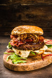 BBQ Burger with Bacon and Onions Royalty Free Stock Photography