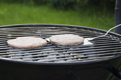 BBQ Burgers. On the grill Stock Image