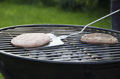 BBQ Burgers. On the grill Stock Images