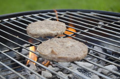 BBQ Burgers. On the grill Stock Photos